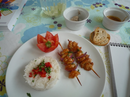 Chicken satay and perfectly cooked rice.