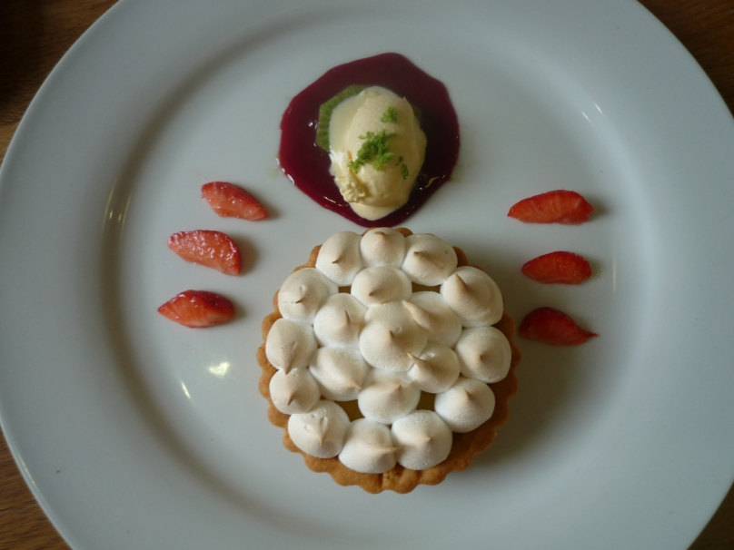 Lemon meringue pie with lime ice-cream and raspberry coulis.