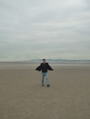 X enjoying Dublin beach.