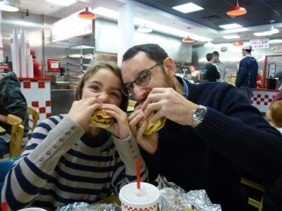 Tucking in to 5 guys burgers.