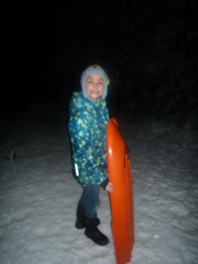 Getting ready for night sledding.